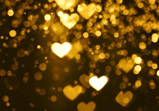 Festive overlay effect. Golden heart bokeh festive glitter background. Christmas, New Year and Valentine's day design.
