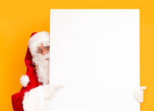 Santa Claus showing on white blank sheet of paper for greetings