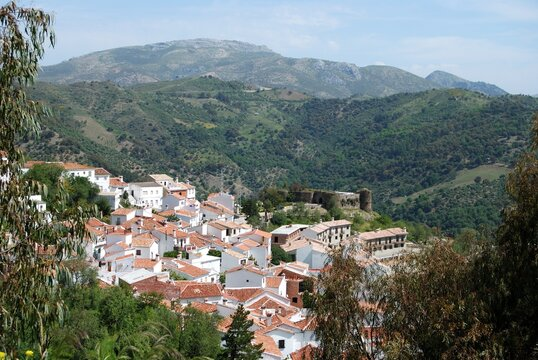 View over village rooftops towards the mountains, Benadalid, Spain.