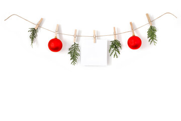 Christmas composition on a white background. Sisal string, fir twigs, Christmas balls, place for your advertisement or text. Wooden laundry clips. copy space, top view, flat photo. December day and Ch