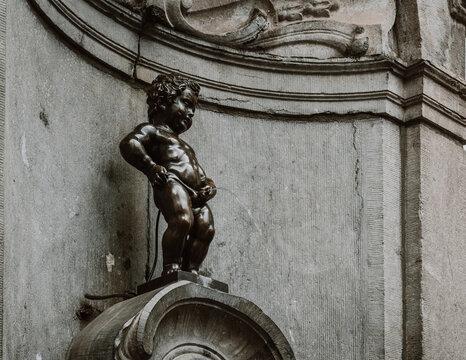 Manneken Pis (Little Pisser) is bronze sculpture in the centre of Brussels, Belgium. Manneken Pis is the best-known symbol of the people of Brussels