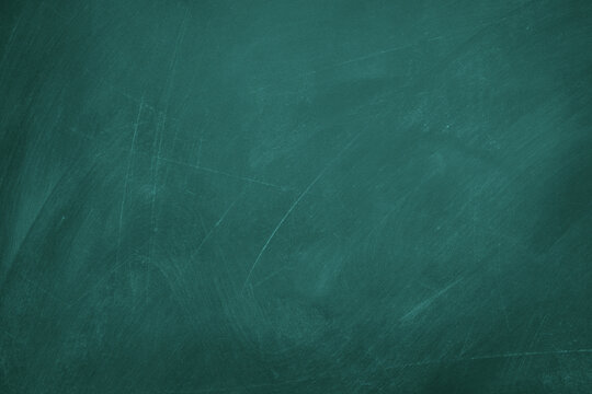 Texture of chalk on green blackboard / chalkboard background, can be use as concept for school education, dark wall backdrop , design template.