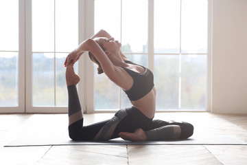 Professional athlete woman making yoga pose at home