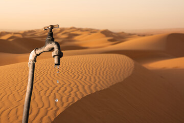 Dripping tap and desert environment in the background