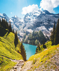 Wall Mural - Idyllic panorama view of the azure lake Oeschinensee. Location place Swiss alps, Kandersteg, Switzerland, Europe.