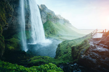 Fotobehang Watervallen Perfect view of powerful Seljalandsfoss waterfall in sunlight. Location place Iceland, Europe.