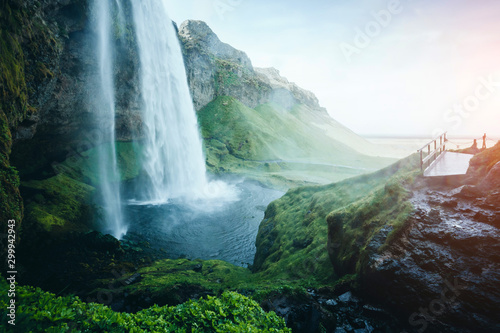 Wall mural Perfect view of powerful Seljalandsfoss waterfall in sunlight. Location place Iceland, Europe.