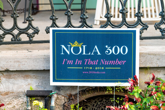 New Orleans, USA - April 23, 2018: Old town Royal street in Louisiana famous city with closeup of NOLA 300 sign on front yard of porch of house