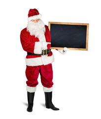 classic traditional red santa claus holding empty wooden slate blackboard chalkboark pointing with...