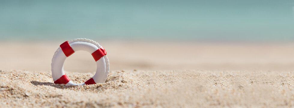 Lifebuoy On Sand At Beach