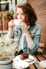 woman drinking coffee in cafe
