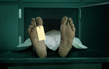 Male human body lying dead at morgue capsule with blank identification label . Close up foot of man cadaver covered with sheet having indentity tag on toe in death concept Wall mural