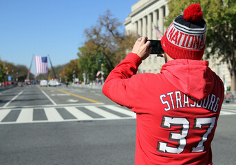 Nationals fan Andrew Dodson, 38, of Alexandria, Virginia, takes a photo of the U.S. flag in Washington
