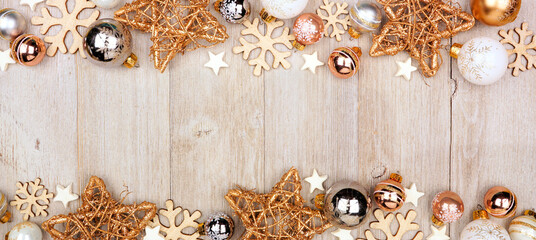 Wall Mural - Christmas double border banner with white and gold ornaments. Top view on a gray wood background with copy space.