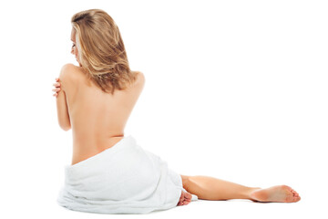 Beautiful blonde woman in white towel on her hips sits naked back on white background. Wall mural