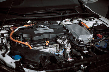 Car gasoline engine. Car engine part. Close-up image of an engine. Engine detailing in a new car