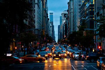 Fototapeta New-York street with many cars eveninng or night