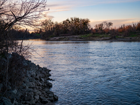Peaceful winter sunset landscape on lower american river .