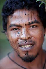 Indigenous leader Paulo Paulino Guajajara smiles for a photo at a makeshift camp on Arariboia indigenous land near the city of Amarante