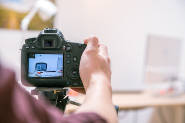 Filming with a digital camera: Man is using a camera standing on a tripod