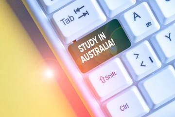 Conceptual hand writing showing Study In Australia. Concept meaning going into foreign country...