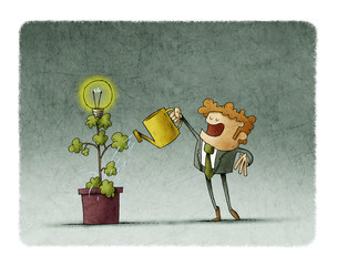 Businessman is watering a plant from which a light bulb blooms.