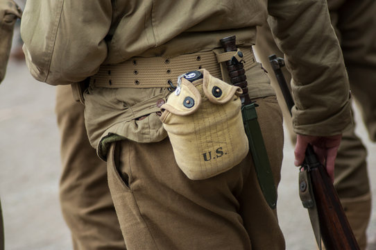 Closeup of american soldier in uniform with water gourd during the world war two reconstitution for the 75th anniversary of the liberation of Alsace in France