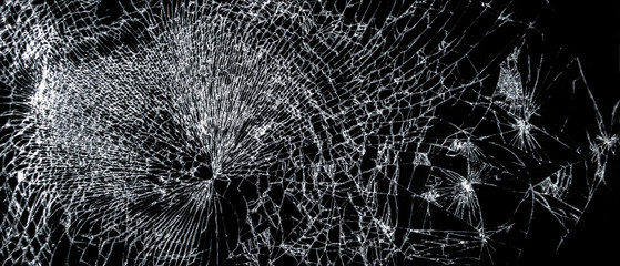 Broken phone screen, large cracked glass on a black background
