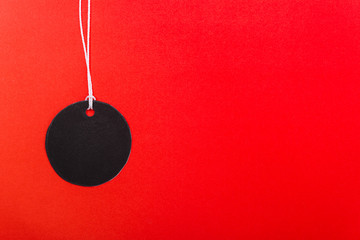 Circle Black tag label on red background