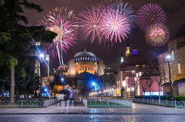 View of the Hagia Sophia at night with fireworks in Istanbul, Turkey. Fototapete