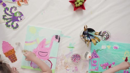 Wall Mural - Flat lay. Little girls are painting on canvas on July 4th party.