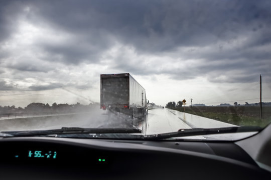 Highway through the windshield during a rainstorm