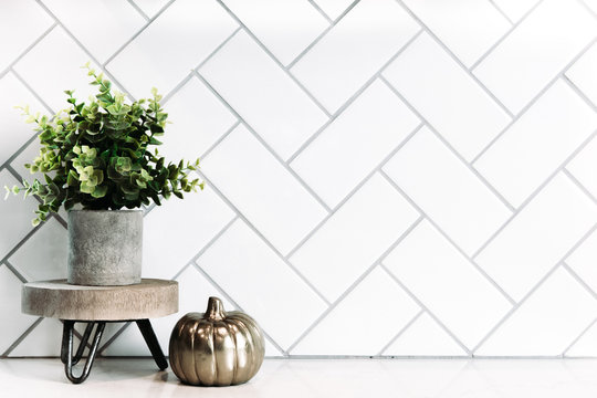 White subway tile background with small minimalist decor