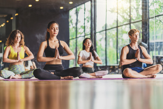 """Group of diversity practicing yoga class, healthy or Meditation Exercise,stretching in upward facing dog exercise, wearing sportswear bra and pants, sports and healthcare concept,."""