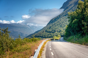 Wall Mural - Highway in the mountains on the Loften Islands in Norway, beautiful landscape, sunset light