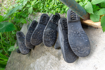 Picture of a 3 pair of rubber boots in the garden - selected focus