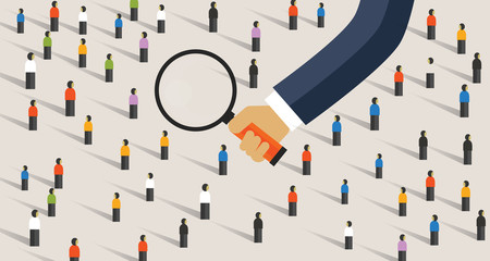 Hand magnify on crowd of people. Concept of recruitment candidate selection or market research looking into customer behavior survey getting data
