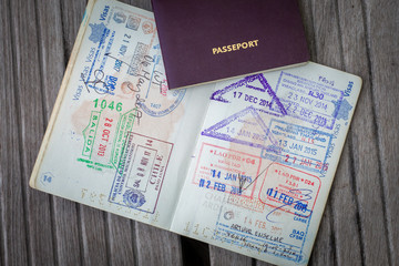 Stamps in a passport, travel life background Fototapete