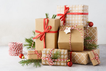 Christmas background with big heap of gift boxes and decoration.