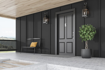 Black door of black house, tree and bench