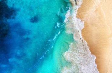 Coast and waves as a background from top view. Turquoise water background from top view. Summer seascape from air. Travel - image