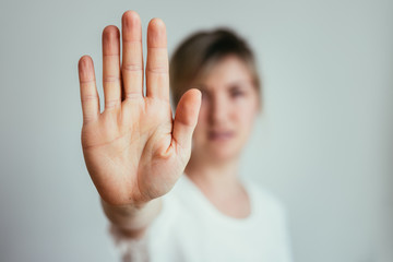 Defense or stop gesture: Girl hand with stop gesture