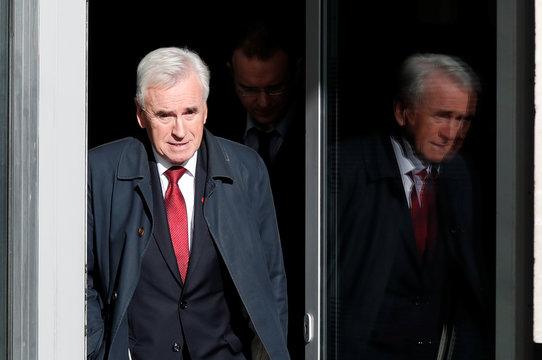 Britain's opposition Labour Party's shadow chancellor John McDonnell leaves the BBC studios after appearing on BBC TV's The Andrew Marr Show in London