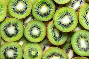 Wall Mural - kiwi fruit slices as textured background