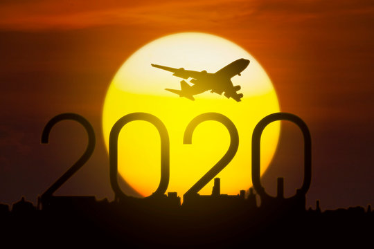 Aircraft flying in the sky above numbers 2020