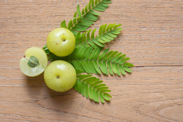 Amla green fruits ,Phyllanthus emblica on wood background.
