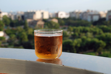 A glass of lager on a ledge above the Turia river park in Valencia, Spain
