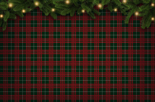 Christmas checkered background with Christmas tree branches