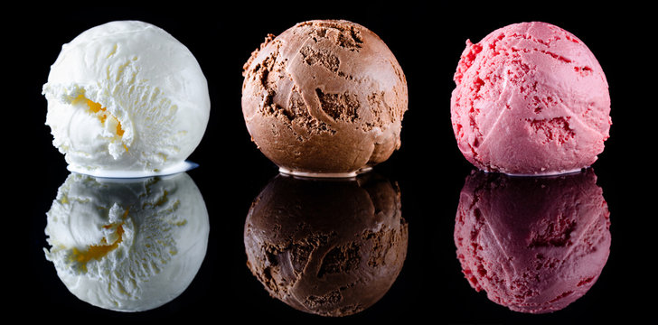 Strawberry ice cream, vanilla ice cream and chocolate ice cream scoops