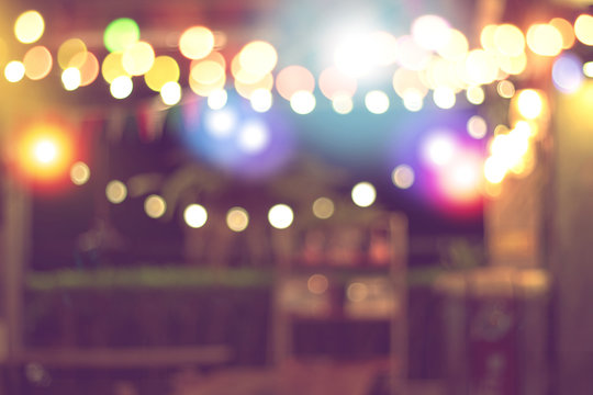 blurred bokeh night lights in restaurant, pub or bar, abstract image of night festival, background party blur celebration concept.